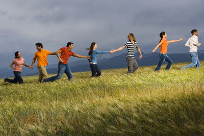 Young People Walking in Meadow